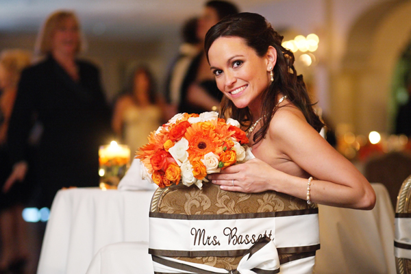 bride with orange flowers at wedding reception