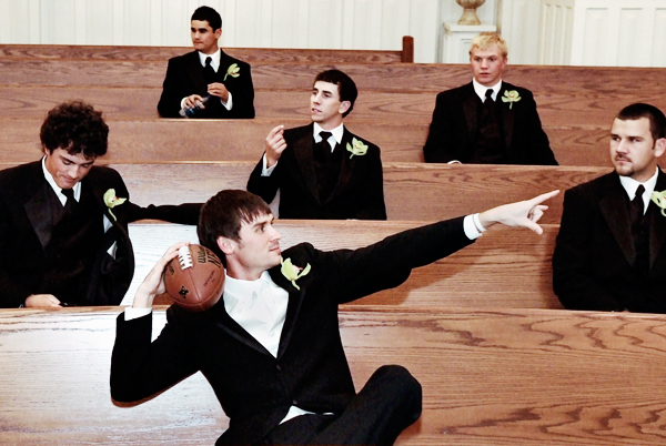 wedding photo of groomsmen with football
