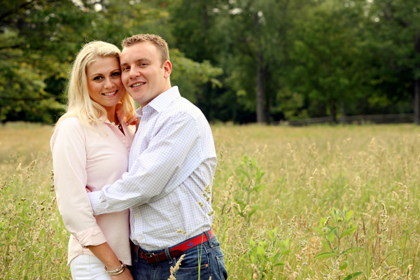 couple standing in tall grass