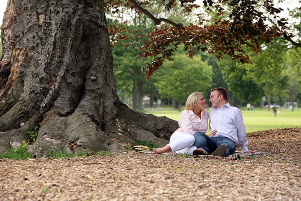 couple sitting underneath a tree