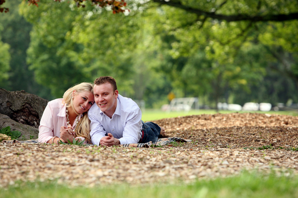 couple laying on the ground smiling