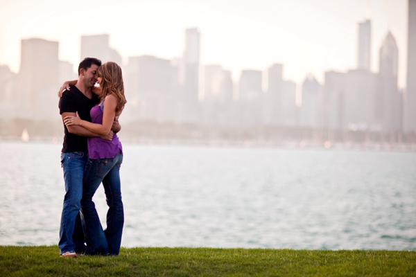Lake Michigan engagement image with Chicago skyline