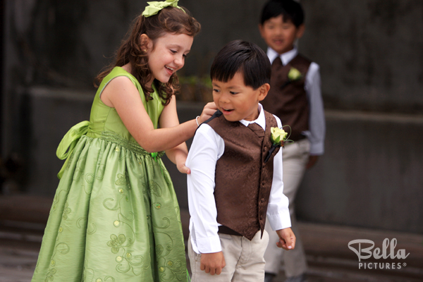 kids at wedding playing dress-up