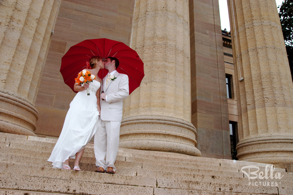 Colorful Umbrellas Brighten up Rainy Wedding Photos