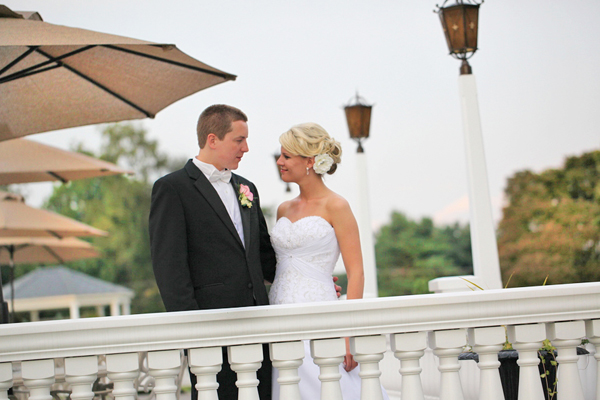 bride and groom portrait on balcony