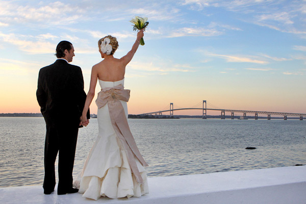 bride and groom looking at sunset