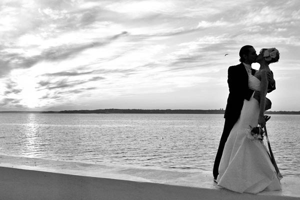 black and white bride and groom at sunset