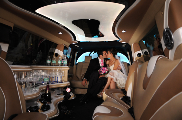 wedding couple kissing in limo photo