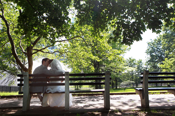 wedding couple kissing in park