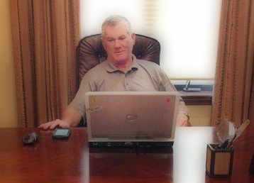 Bill Murphy, founder of Boomeon, working at hs desk