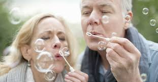 Baby Boomer Couple Blowing Bubbles