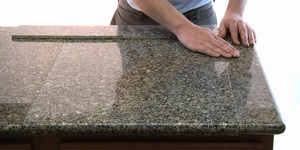 read about Do-It-Yourself Tile Granite Worktop