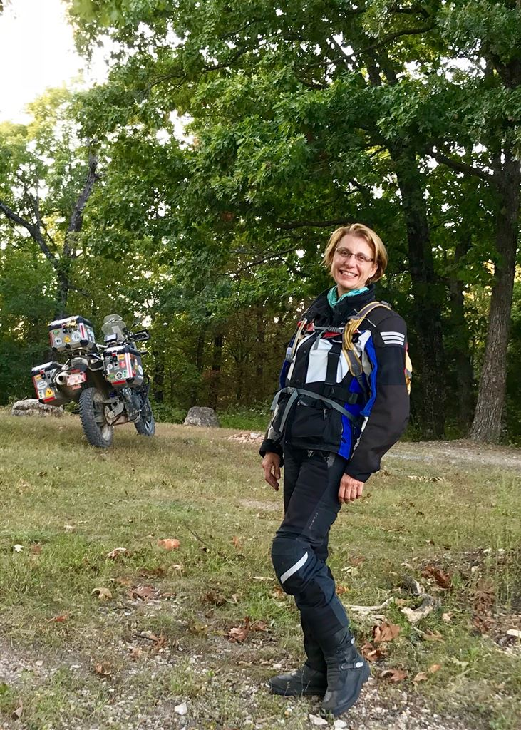 Mary Jo Gracin in field with motorcycle
