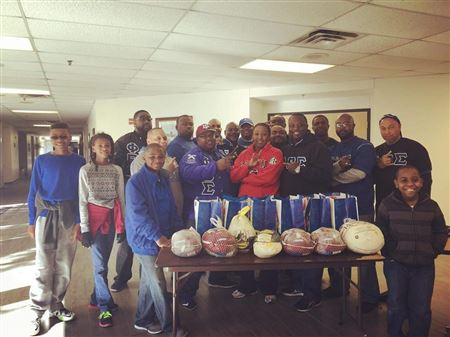 The brothers of Omicron Sigma Chapter delivering turkey baskets to feed over 200 families.