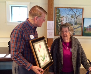 Member Eunice Earle is presented the coveted SAIL Raffle prize by SAIL Board member Ted Walton.