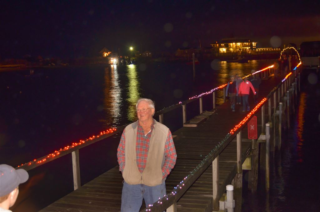 SYC gets in the spirit of the season. Charlie Hall decorates the club house, dock and flagpole as many gather for the lighting on November 28th