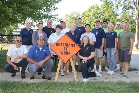 Rotarians Clean Garage, Outbuildings and Yard of elderly couple's home.