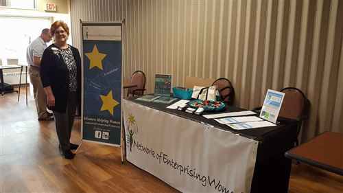 N.E.W. vendor table at Meet the PROs Expo, held on June 8, 2017.