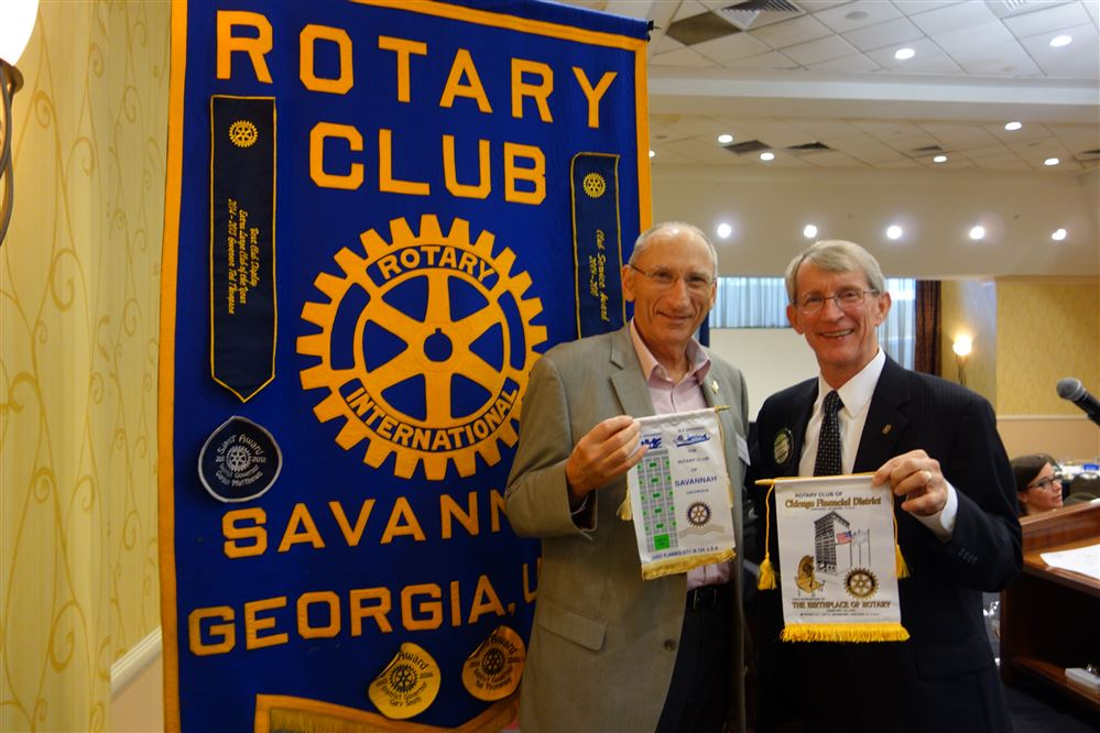 ... banners with Savannah Rotary Club President Rick Monroe. In the other  photo you can