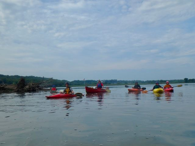 Photos of paddlers and USCG/DNR patrol boats on the Potomac at Rileys Lock and Violettes Lock.