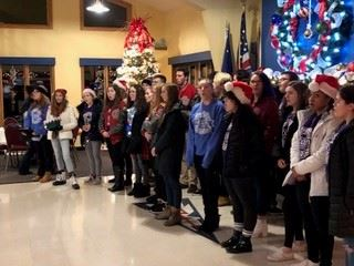 We had the honor of having the Grosse Ile High School Choir preform some songs for the membership.