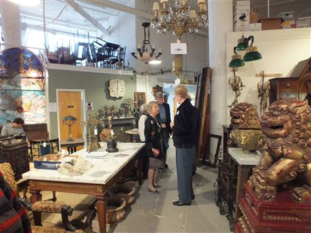On October 13, 2011, East Falls Village members enjoyed wine & cheese while strolling through Kamelot Auction House, 4700 Wissahickon Avenue, at the Edge of East Falls. Kamelot was preparing for an au