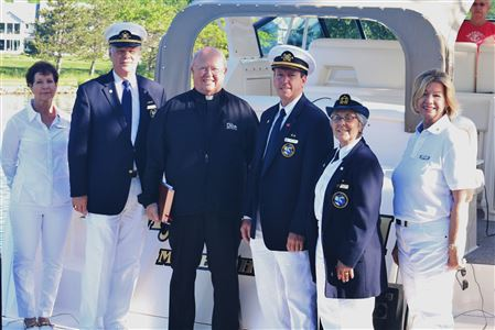 Blessing of the Fleet on 05/29/2016.  Ray Ditmar, Jim Kollmann, Jill Morton, Kathy Wilkens and Father Jim on the Malish yacht.