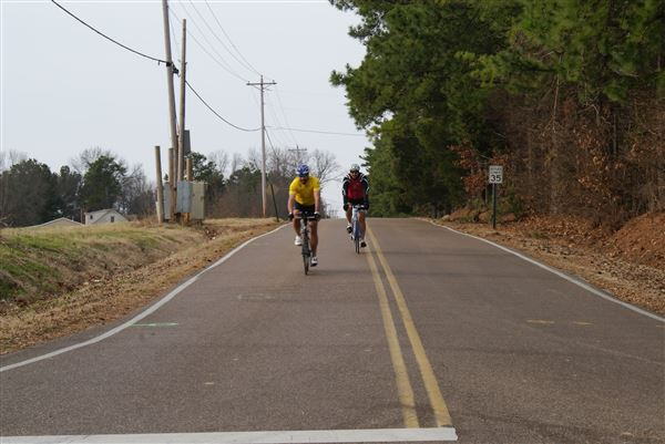 Photos of cyclists and volunteers along the 25-mile loop.