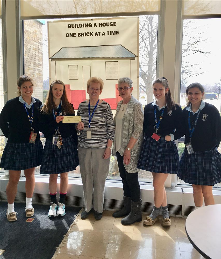 Rosary High School and Marmion Academy Interact Club activities.