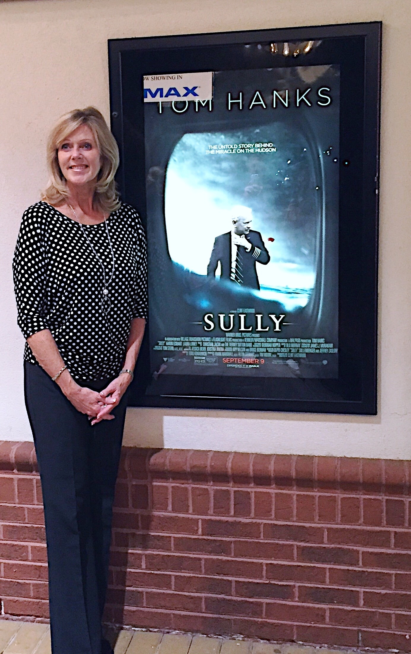 Lori in front of the movie poster