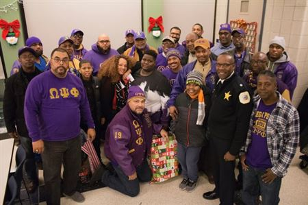 Iota and Epsilon Eta chapters participate in Christmas gift giving event