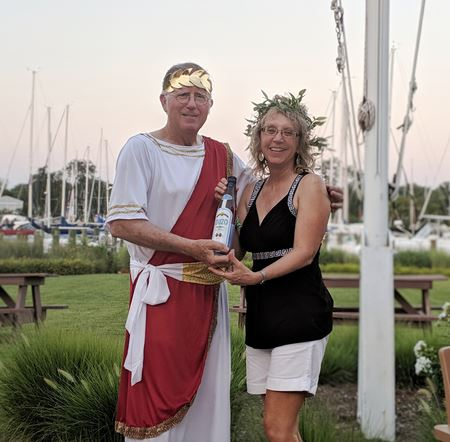 Women Underway hosted the July Dock Hop with a Greek theme-togas, laurel and gold wreaths and plenty of ouzo, dolmas, tabbouleh, baklava, hummus and other delectables.