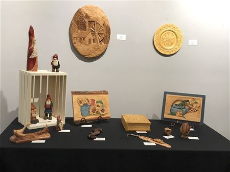 Exhibit showcasing club carvings