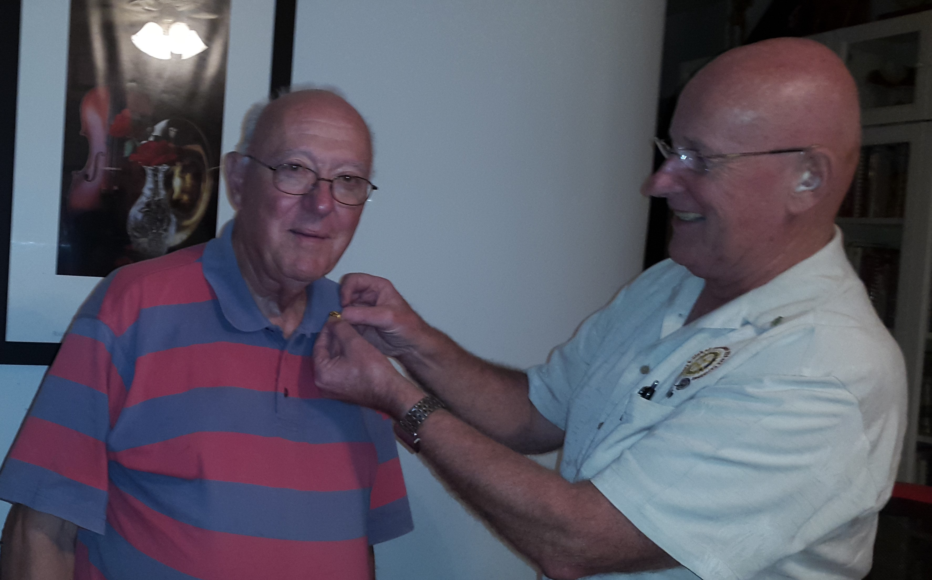 E-Club Treasurer Ray Cornelius receiving his Paul Harris + 2 Pin. Walking the talk on EREY - Every R