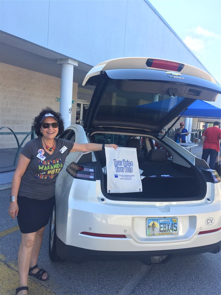 Space Coast EV club held the largest National Drive Electric Week event in Florida. LWVSC had a table and car promoting Next Car Pledge to be an EV.