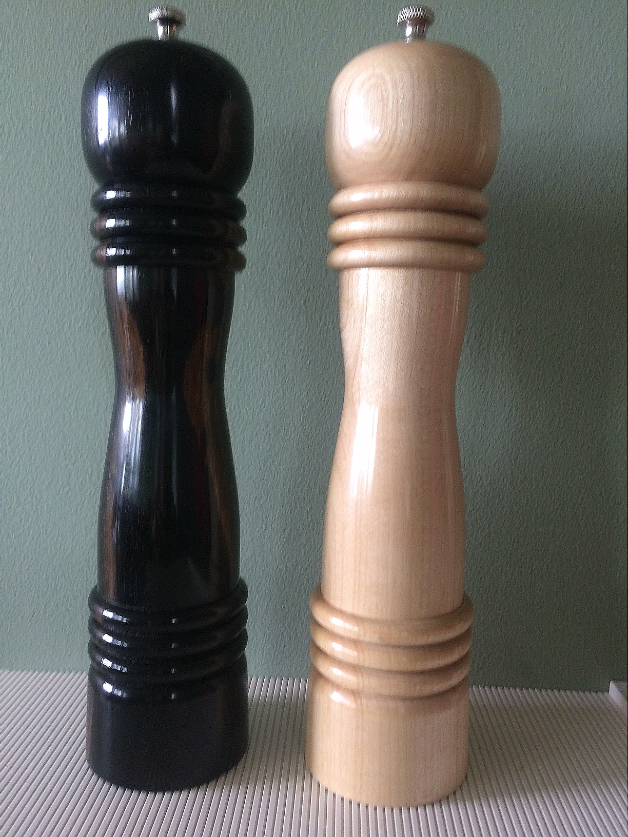 "Hard maple salt and ebony pepper mills--about 12"" tall."