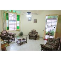 Living Room (16 m2 - 172 sq ft) with TV and ceiling fan and separate entrance through terrace. Key is provided at check in.