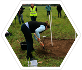 Earthwatch volunteer digging at the Devon archaeological site.