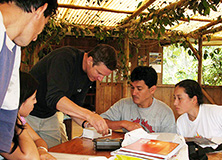 Dr. Mika Peck and rainforest researchers at Santa Lucia Lodge, Ecuador