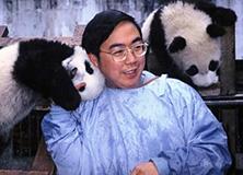 Professor Zhang Hemin with giant pandas