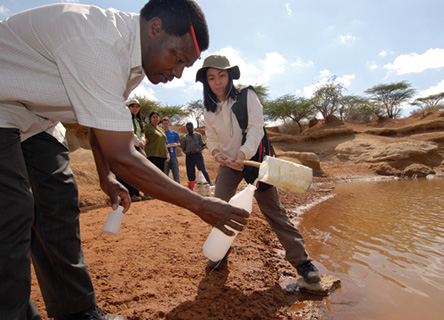 Employees from HSBC carry out tests on water quality during field research with Earthwatch.