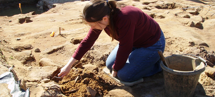 Volunteer digging at a Roman archaeological site in England