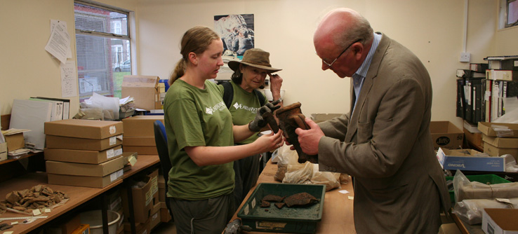 Earthwatch volunteers with archaeological finds from Fort Arbeia.
