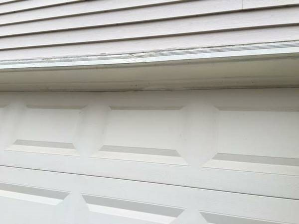 Exterior Wood Trim Around Garage and Front Door Replaces Cover Photo