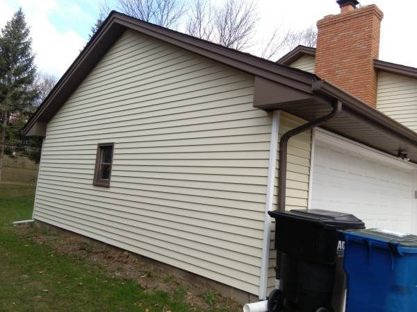 Soffits  Facia  Window Wraps  Gutters Roof Cover Photo