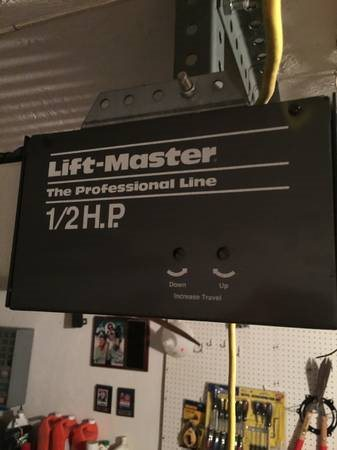 Garage Door Opener And Minor Door Fix  Cover Photo
