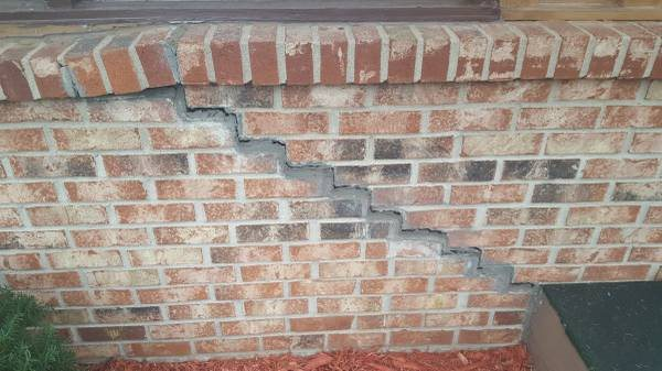 Brick Wall Repair Cover Photo