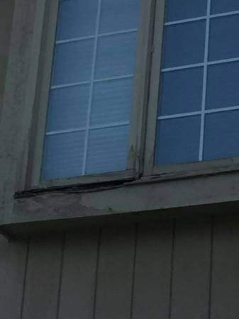 Rotted Wood Windows Cover Photo