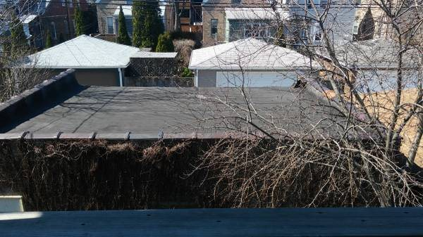 Flat Garage Roof Repaired or Replaced Cover Photo