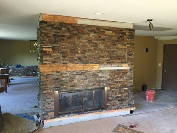 Slate Stone Cut In Straight Lines On Fireplace Cover Photo